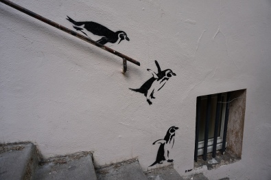 Penguins cascading down steep stairs in Vieux Lyon