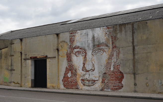 Artwork by Vhils near Aveiro's train station