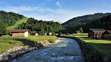 Clean snow melt fills the Loisach river